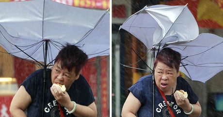 Deadly Typhoon Smashes Into Taiwan, But It Doesn't Stop Her From Enjoying Her Pork Bun
